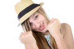 Adolescente sonriente que muestra los puños Imagen de archivo
