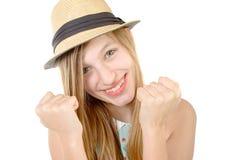 Adolescente sonriente que muestra los puños Foto de archivo libre de regalías
