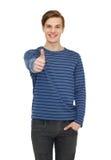 Adolescente sonriente que muestra los pulgares para arriba Imagenes de archivo