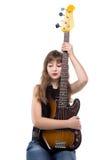 Adolescente sonriente que sostiene una guitarra Fotografía de archivo