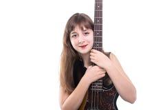 Adolescente sonriente y una guitarra Fotos de archivo