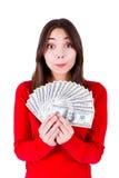Adolescente sorprendido con el dinero Foto de archivo libre de regalías
