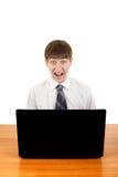 Adolescente sorprendido con el ordenador portátil Imágenes de archivo libres de regalías