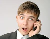 Adolescente sorprendido con el teléfono Imagenes de archivo