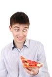 Adolescente sorprendido con la pizza Imagen de archivo libre de regalías