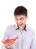 Adolescente sorprendido con la pizza Fotos de archivo
