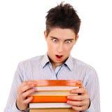 Adolescente sorprendido con libros Imagenes de archivo