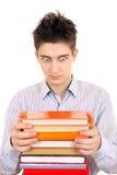 Adolescente sorprendido con los libros Fotos de archivo libres de regalías