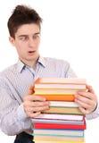 Adolescente sorprendido con los libros Fotografía de archivo libre de regalías