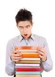 Adolescente sorprendido con los libros Imagen de archivo