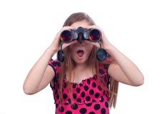 Adolescente sorprendido que mira con los prismáticos Imagen de archivo libre de regalías