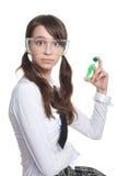 Adolescente sorpreso con la provetta Immagini Stock