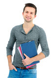Adolescente sorridente con i libri Immagini Stock