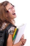 Adolescente sorridente sveglio che va al banco Immagini Stock