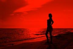 Adolescente sur la plage Photos stock