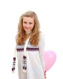 Adolescente tímido que esconde um ballon do coração atrás Fotografia de Stock