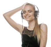 Adolescente talentoso dulce joven en auriculares Imagen de archivo