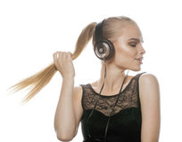 Adolescente talentoso dulce joven en auriculares Fotografía de archivo libre de regalías