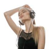 Adolescente talentoso dulce joven en auriculares Imagen de archivo libre de regalías