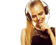Adolescente talentoso dulce joven en el canto de los auriculares aislado Imagen de archivo
