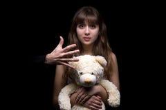 Adolescente temeroso con el juguete Fotografía de archivo libre de regalías