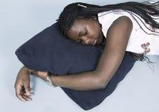 Adolescente tomando una siesta Foto de archivo libre de regalías