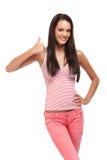 Adolescente trigueno feliz con el pulgar para arriba Imagen de archivo