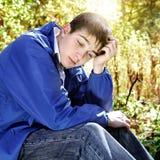 Adolescente triste all'aperto Immagine Stock