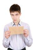 Adolescente triste con cartulina en blanco Fotografía de archivo libre de regalías