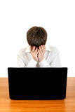Adolescente triste con el ordenador portátil Fotos de archivo