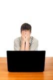 Adolescente triste con el ordenador portátil Fotografía de archivo libre de regalías