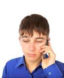 Adolescente triste con el teléfono Imágenes de archivo libres de regalías