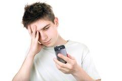 Adolescente triste con il telefono Fotografia Stock Libera da Diritti