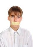 Adolescente triste con la boca sellada Fotografía de archivo libre de regalías
