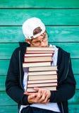 Adolescente triste con libri Immagini Stock