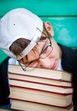 Adolescente triste con libri Fotografia Stock