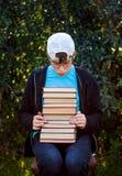 Adolescente triste con libri Fotografie Stock Libere da Diritti