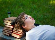 Adolescente triste con libros Fotografía de archivo libre de regalías