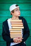 Adolescente triste con libros Foto de archivo libre de regalías
