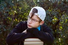 Adolescente triste con libros Foto de archivo