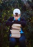 Adolescente triste con los libros Fotos de archivo libres de regalías