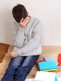 Adolescente triste con los libros Imágenes de archivo libres de regalías