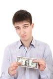 Adolescente triste con un dólar Fotos de archivo libres de regalías