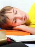 Adolescente triste con un libro Imagen de archivo libre de regalías