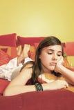 Adolescente triste en cama Foto de archivo libre de regalías