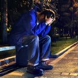 Adolescente triste en el parque Fotos de archivo