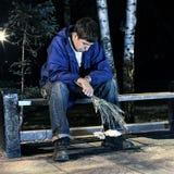 Adolescente triste en el parque Fotografía de archivo libre de regalías