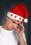 Adolescente triste en el sombrero de Santas Imagen de archivo libre de regalías
