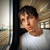 Adolescente triste en el tren Fotos de archivo