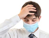 Adolescente triste en máscara de la gripe Fotos de archivo
